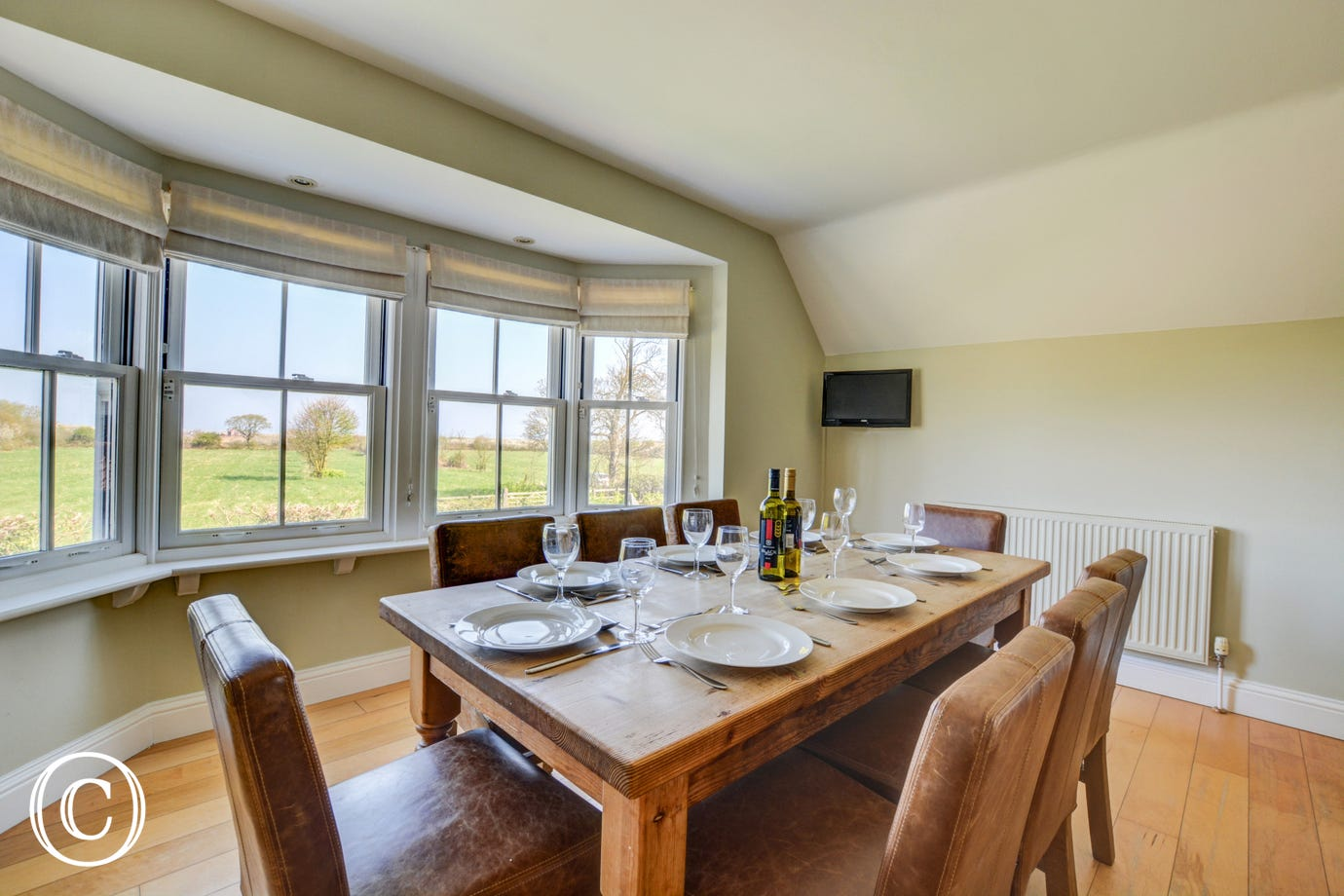 Light and airy dining area with table and chairs to seat 8 and great views from the bay window, perfect for family meals