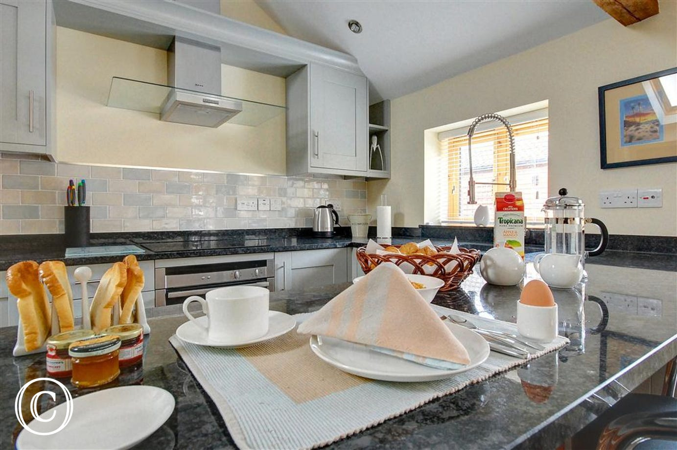Enjoy a hearty breakfast together on this granite style work top in the kitchen area.