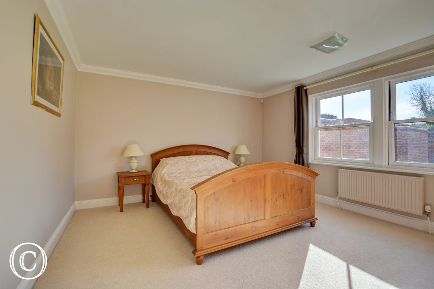 Large double bedroom with a king-size bed and en-suite shower room with shower cubicle