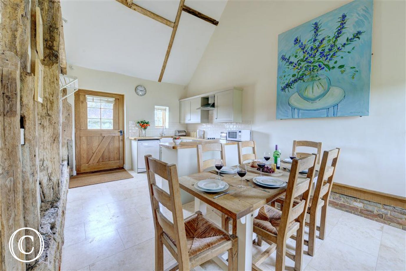 Spacious kitchen and dining area with superb travertine marble floor