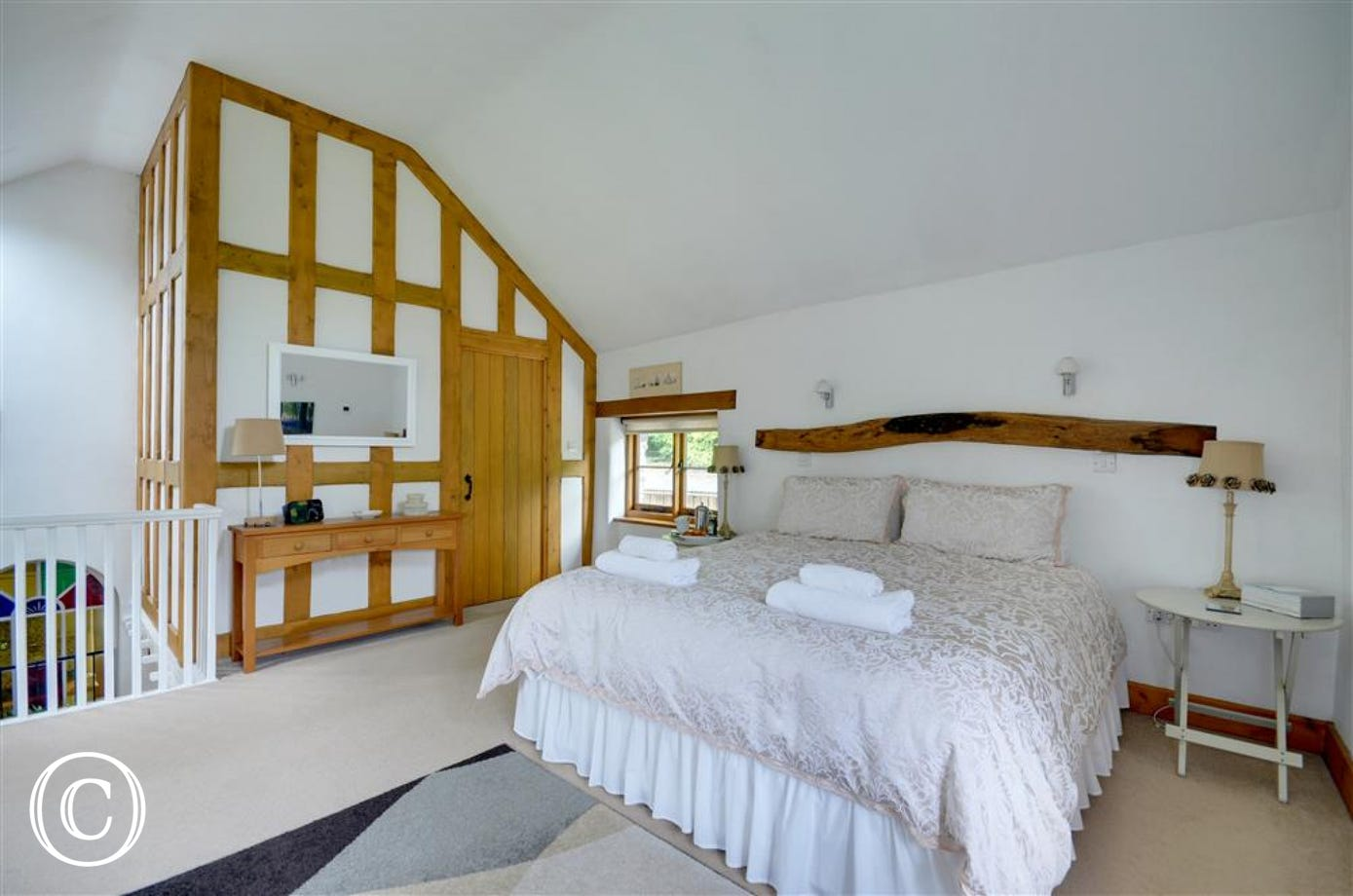 Beautifully decorated bedroom with super king size bed and ensuite bathroom