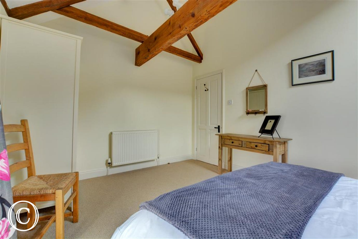 Open beams and furniture in bedroom two
