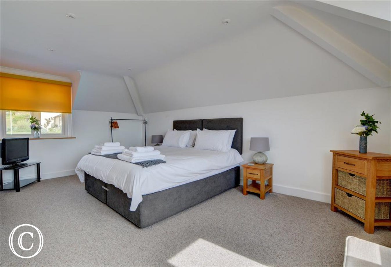 Large master bedroom with Superking, sea views and en suite bathroom with spa bath