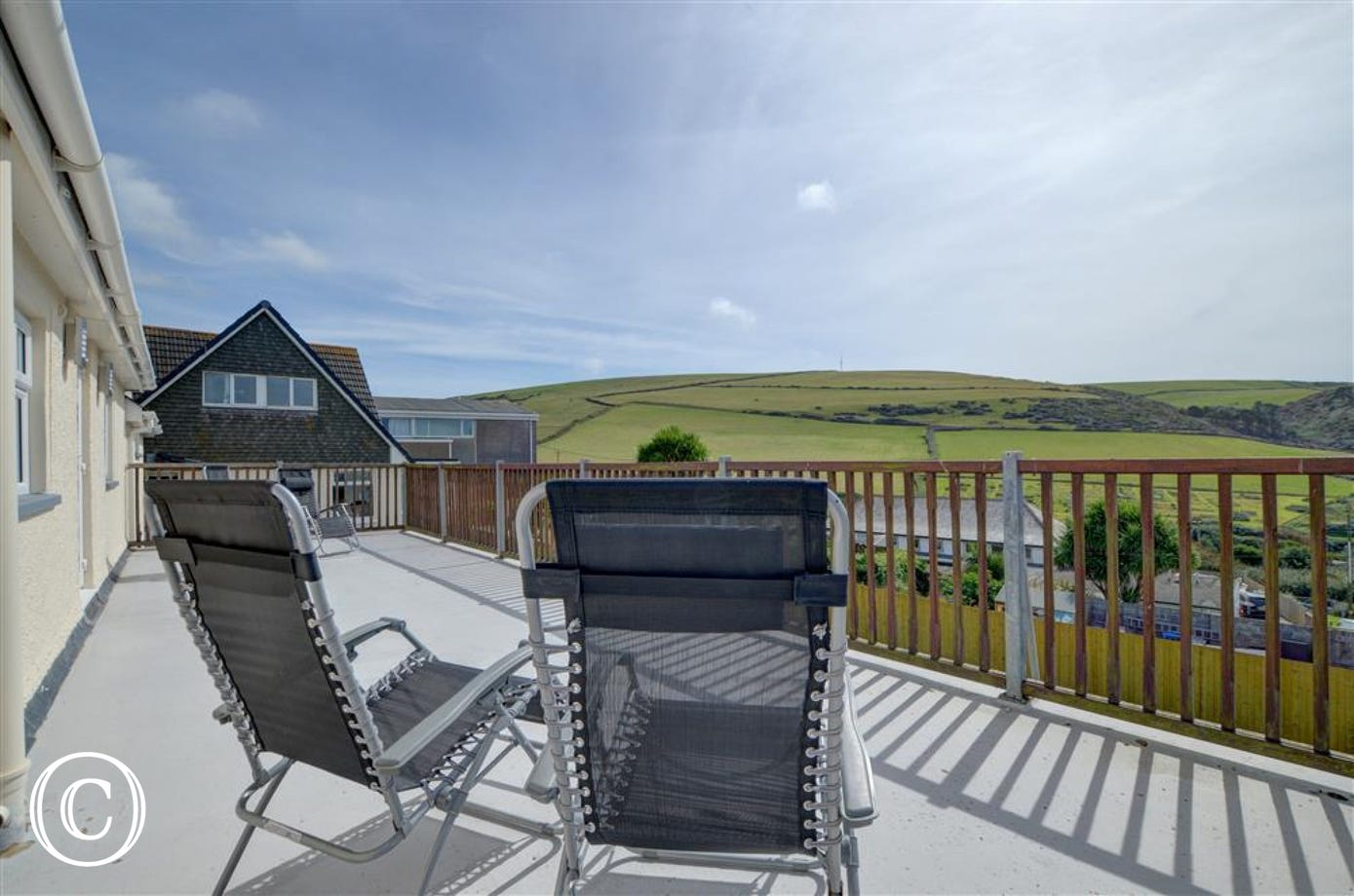 Large south facing balcony where guests can enjoy the stunning sea views