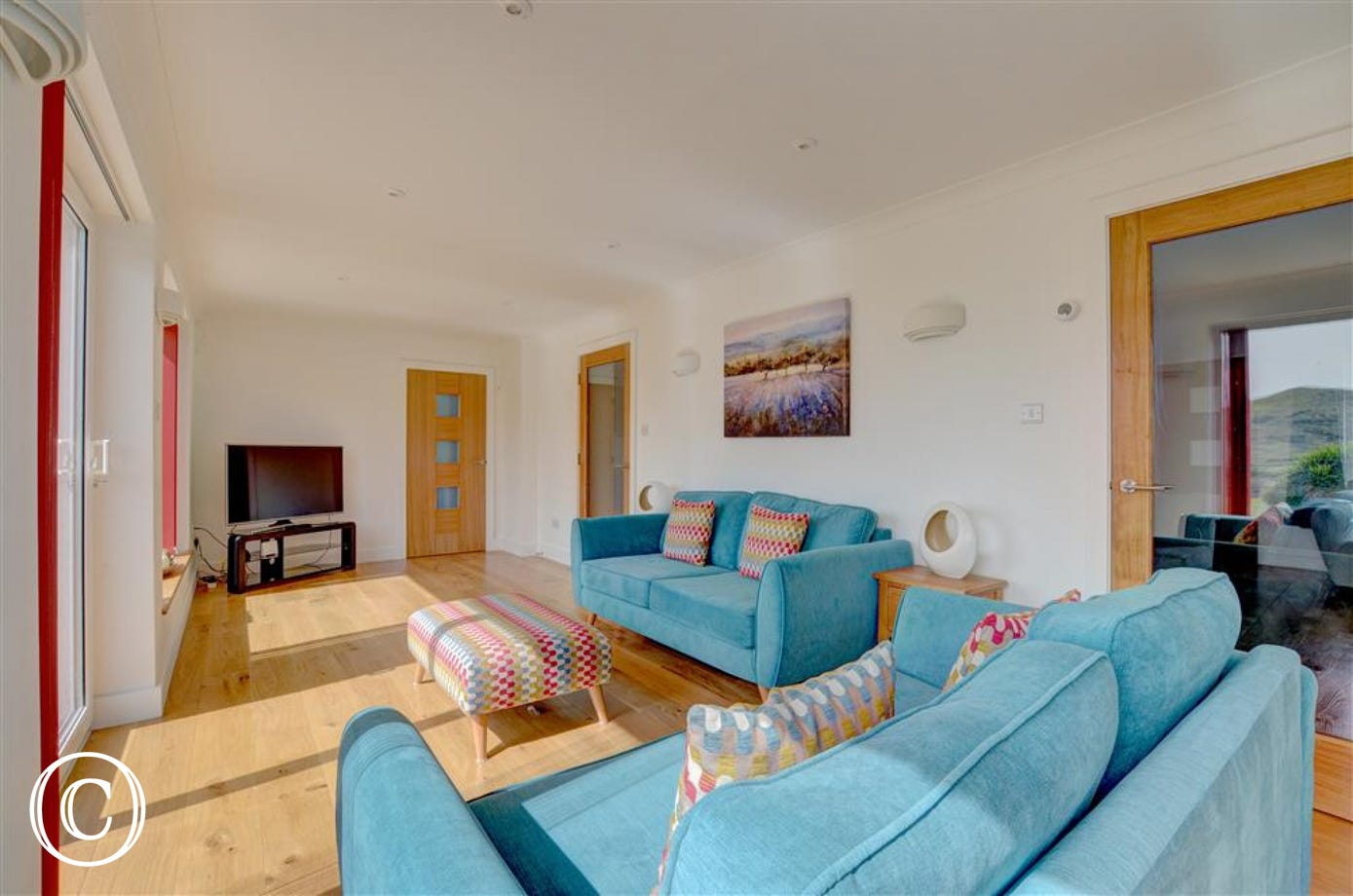 The second sitting room has a large TV, comfortable seating and lovely views