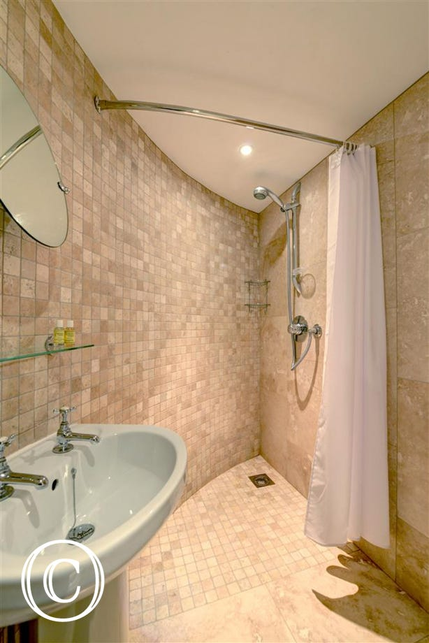 Fully tiled en-suite wet room, attached to bedroom 1