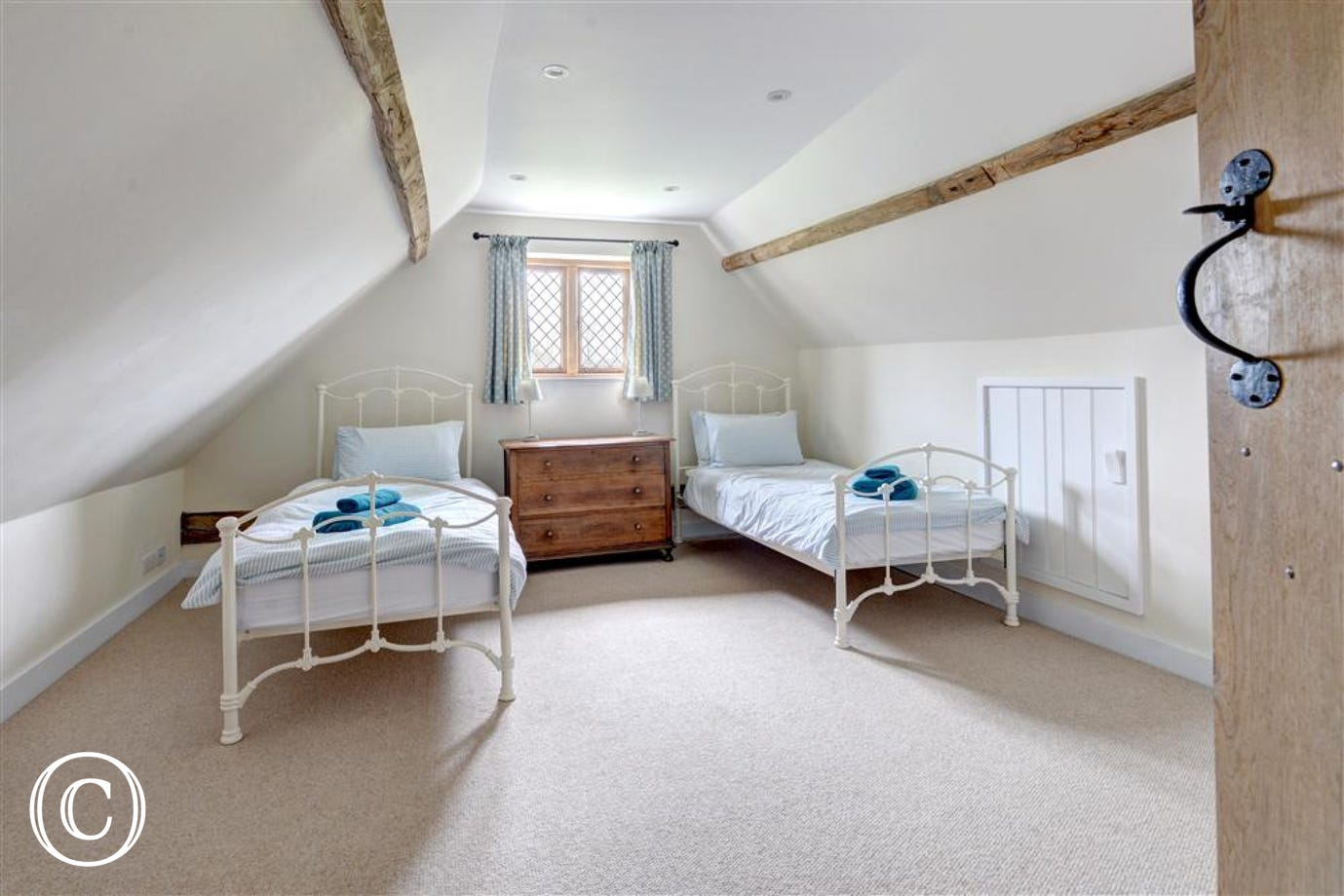 A sweet room with two single beds and glorious views over the fields.