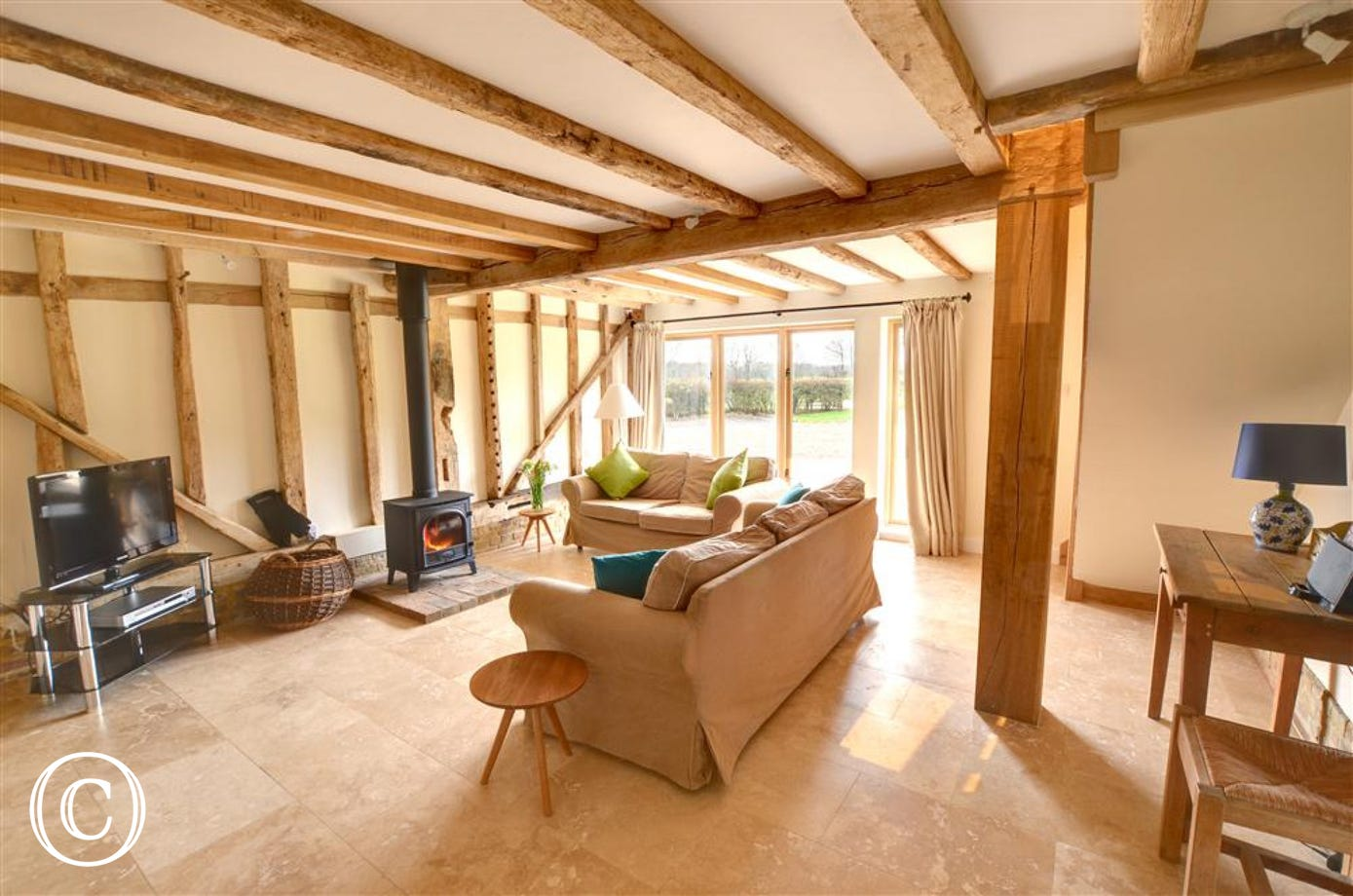 Wonderful under floor heating and free-standing wood burning stove in this truly stunning sitting room