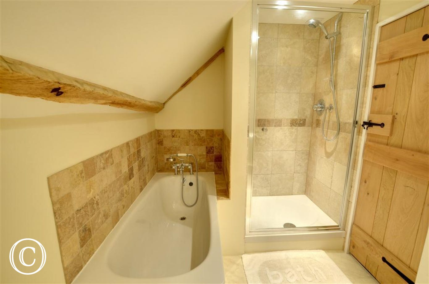 Stylish bathroom with a deep bath and separate shower cubicle