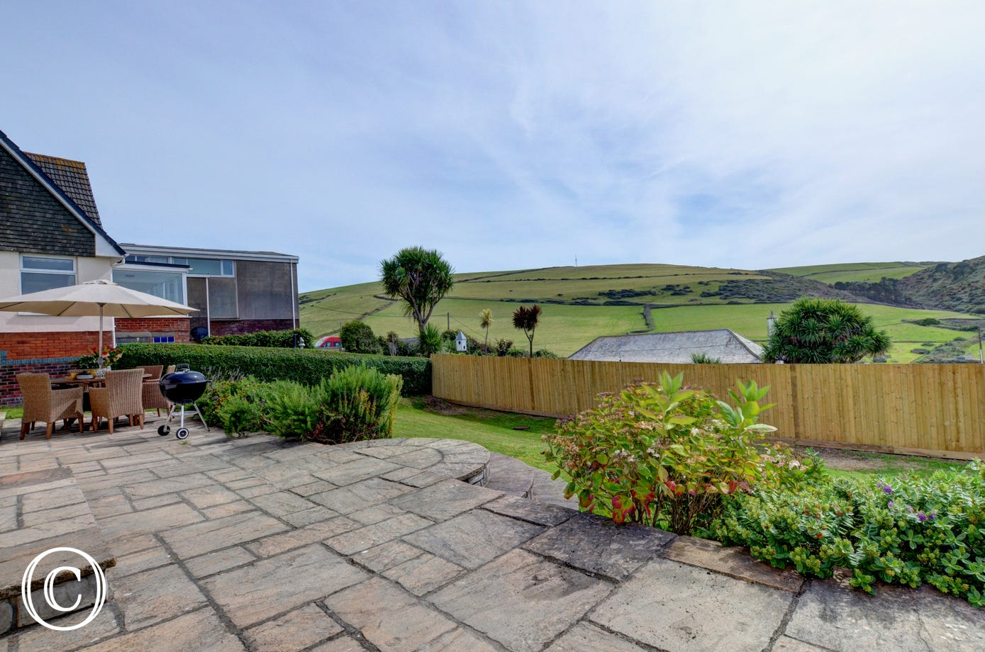 Large patio and garden area, perfect for socialising in after a day at the beach
