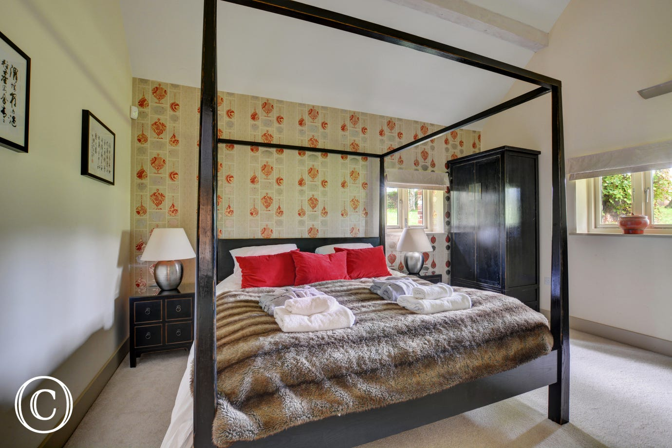 Master bedroom with a king size four poster bed, Smart TV
