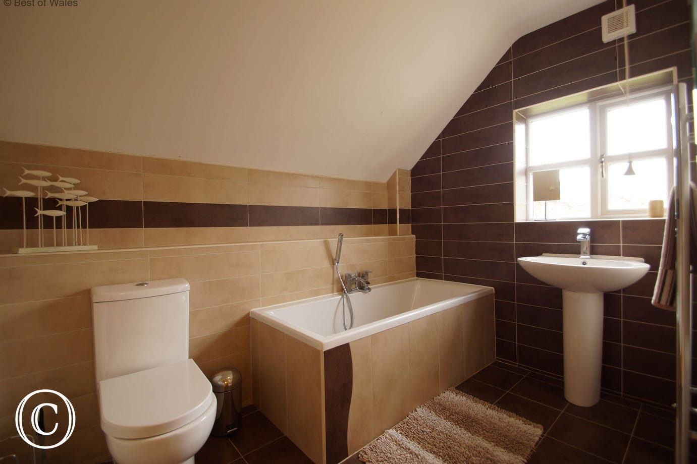 Bathroom with shower over centre of bath & heated towel rail