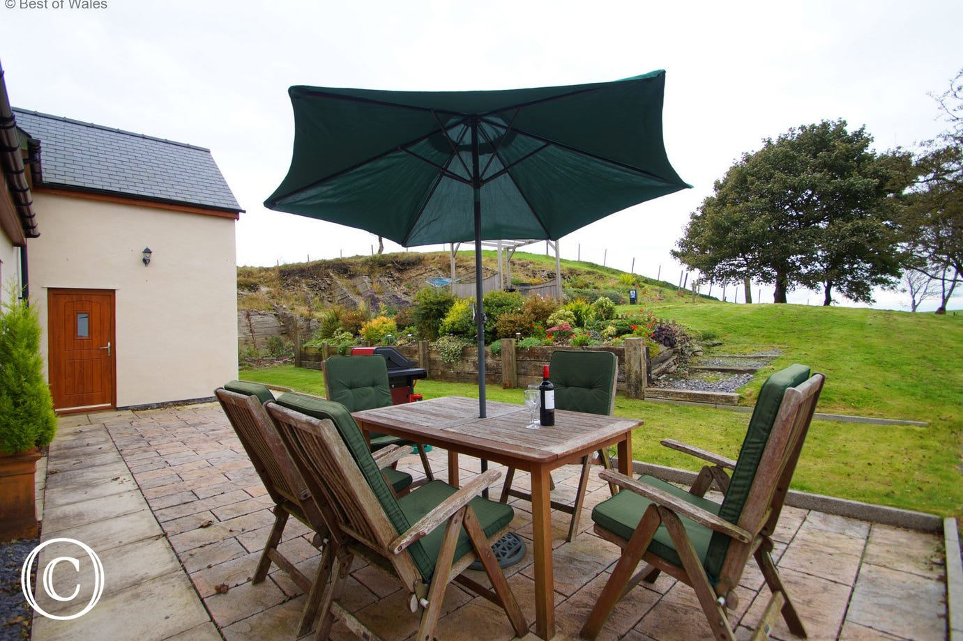 Large enclosed garden with patio furniture, BBQ and Gazebo.