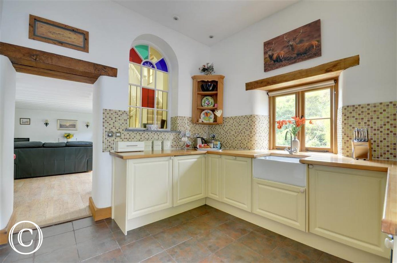 Belfast style skin in the kitchen and stain glass feature window