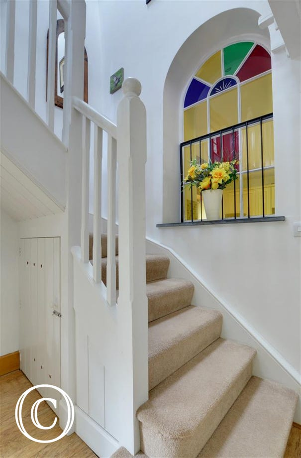 Stairs and ornate stain glass window