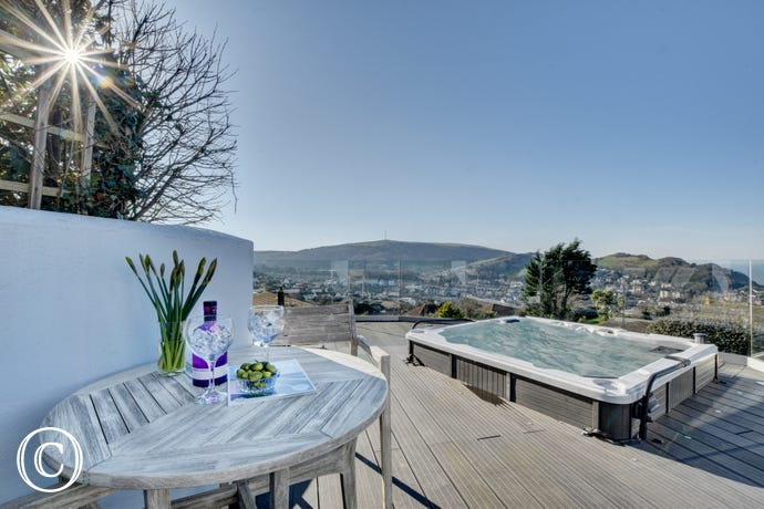 The decked terrace area with hot tub and magnificent views